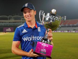 England captain Jos Buttler poses for a photograph with the winner's trophy