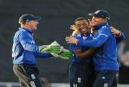 England's Chris Jordan is congratulated by Jos Butler and Alex Hales