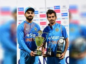 Virat Kohli with Yuzuvendra Chahal with the trophy after winning the series against England during the 3rd T20 between India and England