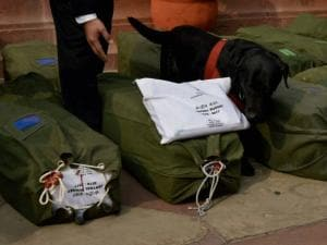 Security personnel  with a sniffer dog checking  documents of Union Budget 2016-17