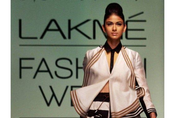 A model walks the ramp on the first day of Lakme Fashion Week