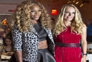 Serena Williams poses with U.S. Open runner-up Caroline Wozniacki