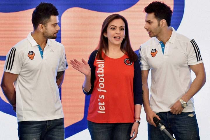 Nita Ambani, founding chairperson, Football Sports Development with cricketer and co-owner, FC Goa, Virat Kohli, actor, Varun Dhawan, press conference, Mumbai