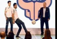 Cricketer Virat Kohli juggles a football as ISL franchise FC Goa's coach Zico and actor Varun Dhawan looks