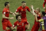 Kevin De Bruyne celebrates scoring the opening goal during the World Cup round of 16 soccer match.