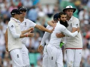 England's Moeen Ali, celebrates taking the wicket of Australia's David Warner