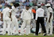 India's Ishant Sharma and captain MS Dhoni ask the umpire K Dharmasena about the pitch