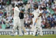 India's MS Dhoni and teammate Ishant Sharma bump fists