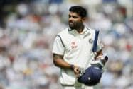 India's Murali Vijay looks at a large video screen to see how he lost his wicket