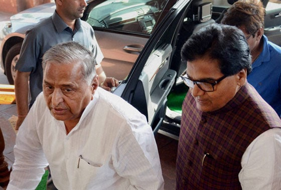 SP chief Mulayam Singh Yadav with party MP Ram Gopal Yadav