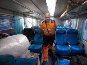 Official inspecting Spanish train Talgo after it arrives from Delhi during its trial run in Mumbai