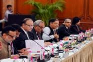 Finance Minister Arun Jaitley flanked by officials