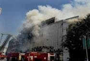 Fire personnel dousing a fire that broke out at Rama Building in Connaught Place