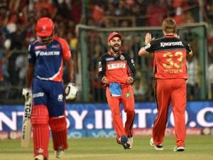 Royal Challengers Bangalore bowler Shane Watson with Virat_Kohli celebrate the wicket of Sanju Samson of Delhi Daredevils during Indian Premier League (IPL) 2016 T20 match
