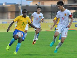 Footballers of China and Brazil in action during the 1st BRICS U-17 football tournament