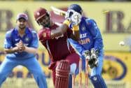 West Indies Cricketer Dwayne Smith is bowled out by India's Ravindra Jadeja