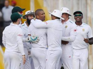 Vernon Philander with teammates celebrates the wicket of India's R Jadeja
