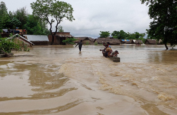 view, flooded road, Tikonia, area, Indo-Nepal border, Lakhimpur Kheeri