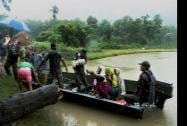Army troop rescuing people from flood affected Kalapani village