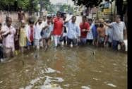 Locals simulate fishing during a protest against the Bihar Government over waterlogging