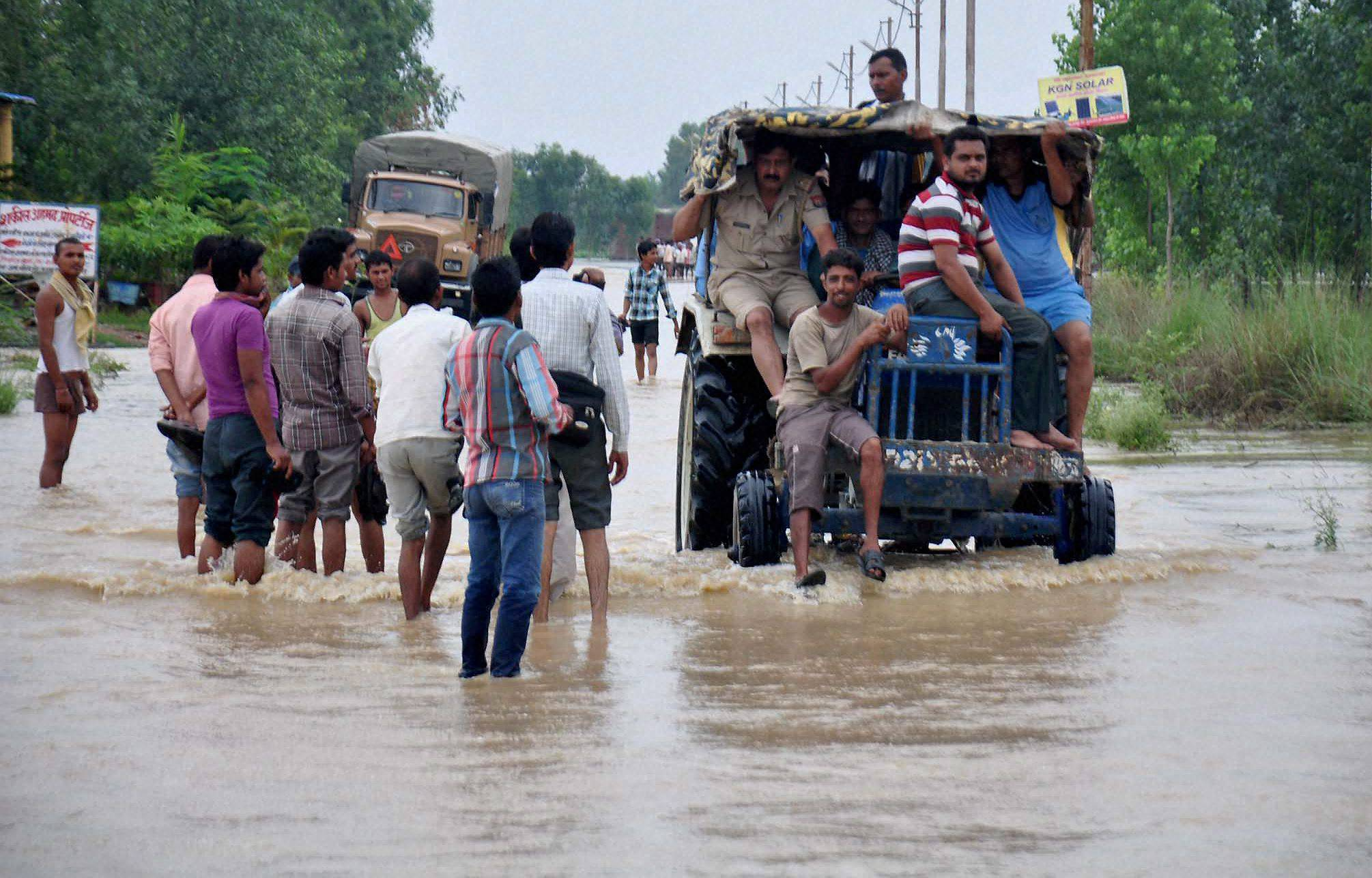 People, road, locality, flooded, Ramganga River, Moradabad district