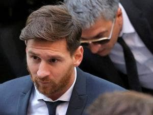Barcelona soccer player Lionel Messi arrives at a court in Barcelona, Spain