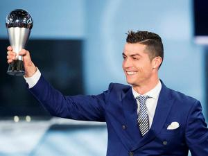 Cristiano Ronaldo of Portugal poses with the trophy after winning The Best FIFA Men's Player award