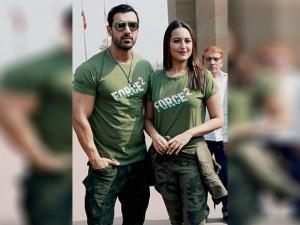 John Abraham and Sonakshi Sinha pose after paying homage to martyrs at Amar Jawan Jyoti at India Gate