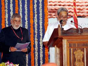 BJP leader Manohar Parrikar taking oath as Goa's new Chief Minister at a swearing-in ceremony in Panaji