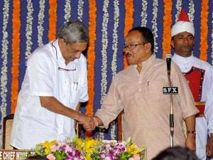 Goa's new Chief Minister Manohar Parrikar being greeted by his predecessor Lakshmikant Parsekar