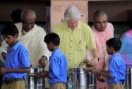 Former US President Bill Clinton serves food to students at 'Akshaya Patra' kitchen in Jaipur