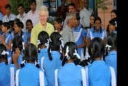 Former US President Bill Clinton with students during a visit to 'Akshaya Patra' kitchen in Jaipur