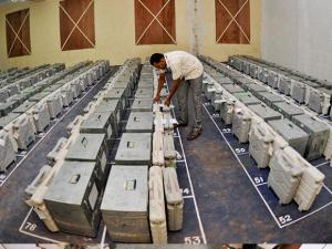 An officer checking sealed electronic voting machines at GCT College in Coimbatore after elections
