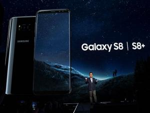 Koh Dong-jin shows the Galaxy S8 and S8 Plus during a news conference in New York