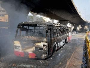 Charred buses which were torched by garment workers during a protest rally over EPF withdrawal norm, in Bengaluru