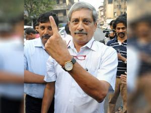 Defence Minister Manohar Parrikar showing his indelible ink marked finger after casting his vote at a polling booth in Goa