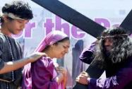 A person dressed as Jesus Christ is re-enacting the crucifixion on 'Good Friday' in Mumbai