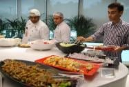 The lunch buffet in the cafeteria that has a live kitchen