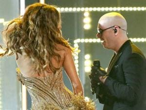 Sofia Vergara, left, and Pitbull perform at the 58th annual Grammy Awards