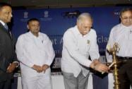 Union Minister of Civil Aviation P Ashok Gajapathi Raju lighting the lamp during the inauguration of the Gujarat aero conclave
