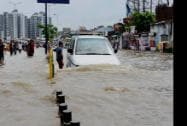 A flooded road after heavy rains in Ahmedabad