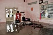 An army man in his flooded room in Ahmedabad