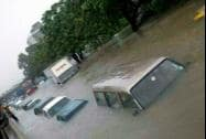 Vehicles stuck at a flooded road during heavy rains