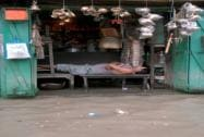A man takes nap at a flooded market near Kalighat Kali temple