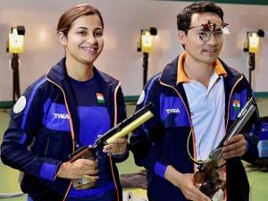 Heena Sidhu and Jitu Rai celebrate after winning the mixed team 10m Air Pistol event