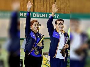 Heena Sidhu and Jitu Rai celebrate after winning the mixed team 10m Air Pistol event of the ISSF World Cup