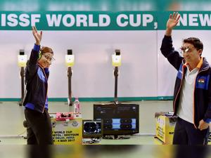 Heena Sidhu and Jitu Rai celebrate after winning the mixed team 10m Air Pistol event of the ISSF World Cup in New Delhi