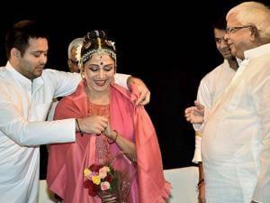 Bihar Deputy CM Tejashwi Yadav offers a shawl to Hema