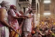Devotees celebrate holi at Bankey Bihari Temple