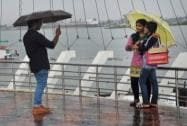 People enjoy a rainy day at Marain drive in Kochi